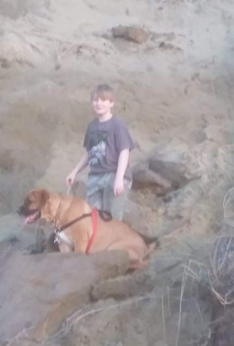 Wyatt Tofte and his dog Duke on a hike the day before Labor Day, when historic winds fueled the Beachie Creek Fire.