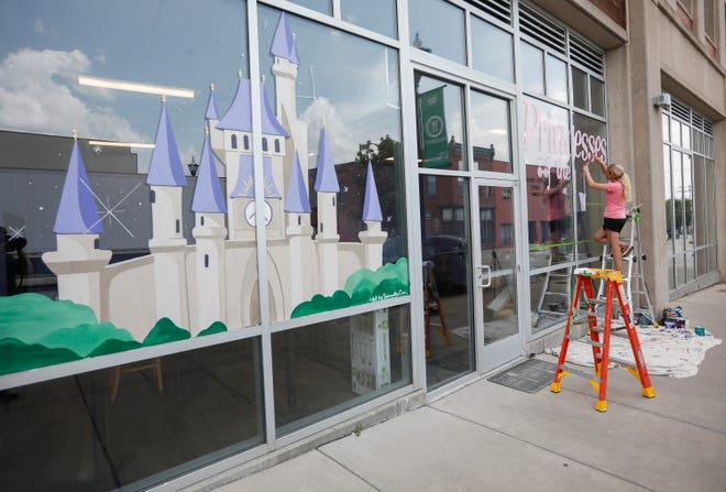 A mural is painted on the window of Princesses of the 417, located on W. College Street in downtown Springfield, on Wednesday, July 14, 2021.