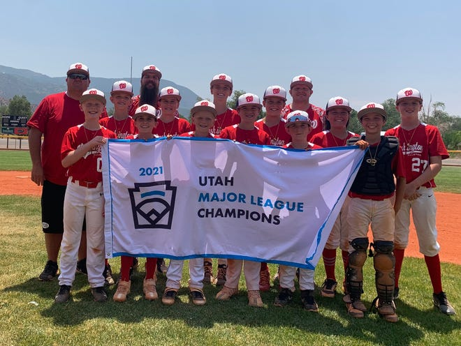 The Washington Little League All-Stars pose with their 2021 state championship banner.