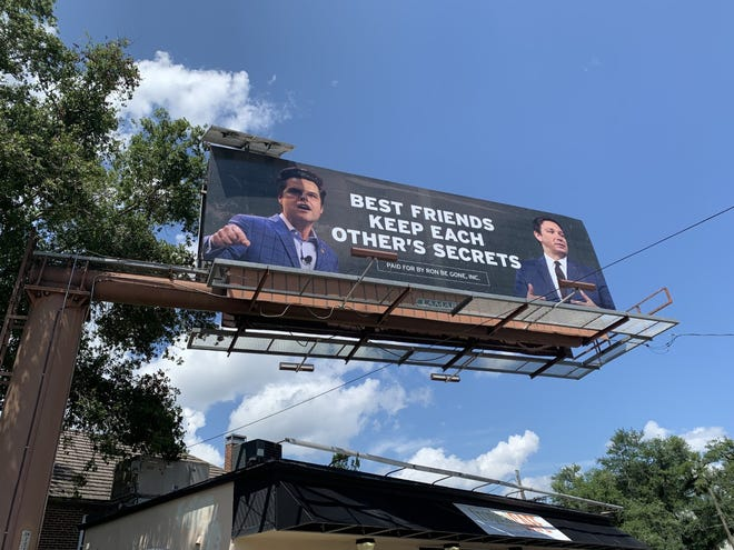 """An anti-DeSantis billboard advertisement near the Governor's Mansion was installed Wednesday. It reads, """"Best friends keep each other's secrets."""""""