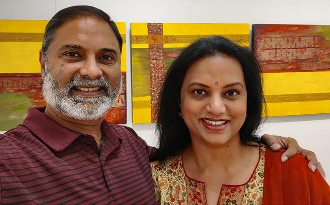 Brinda Pamulapati with husband, Veernag, in front of  1965: Mixed Media -Acrylic paint, Saree on Board (Kanchi Saree).