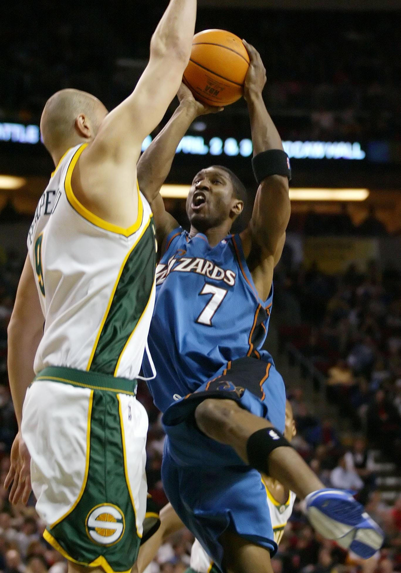 The Washington Wizards' Laron Profit (7) drives to the basket against the Seattle SuperSonics' Vitaly Potapenko March 27, 2005.