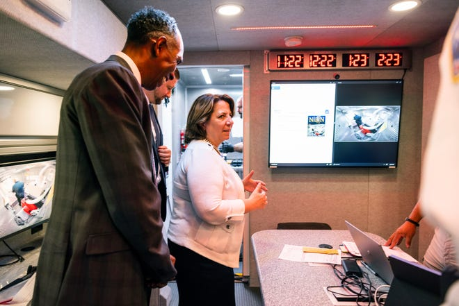Deputy Attorney General Lisa Monaco and Acting Director of Alcohol, Tobacco and Firearms (ATF), Marvin G. Richardson, visit a mobile command center of the ATF Crime Gun Intelligence, which provides ballistic processing to investigators, in Washington on Thursday, July 22, 2021 Crime scenes made possible.