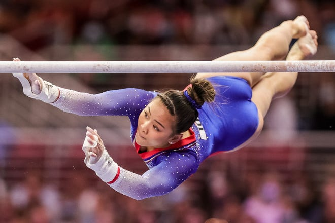Sunisa Lee competes on uneven bars during the 2021 U.S. Olympic Trials.