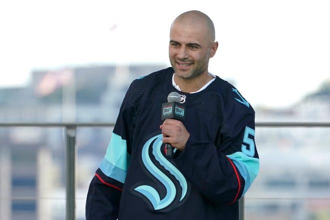 Defenseman Mark Giordano speaks Wednesday after being introduced by the Seattle Kraken.