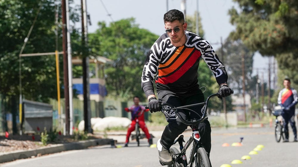 Nick Jonas has revealed the cause of his May biking injury: a mishap while competing in the BMX race portion of