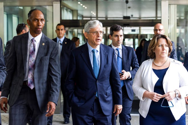 Attorney General Merrick Garland (center) leaves the Alcohol, Tobacco and Firearms Office headquarters with Assistant Attorney General Lisa Monaco (right) and Acting Director of Alcohol, Tobacco and Firearms (ATF) Marvin G. Richardson (left) Washington, Thursday, July 22, 2021.