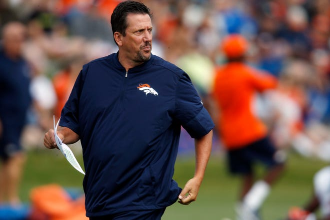 In this Aug. 4, 2016, file photo, Denver Broncos quarterbacks coach Greg Knapp watches during NFL football training camp in Englewood, Colo.