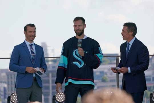 Goalie Chris Dreidger stands with ESPN NHL expansion draft hosts Dominic Moore and Chris Fowler.