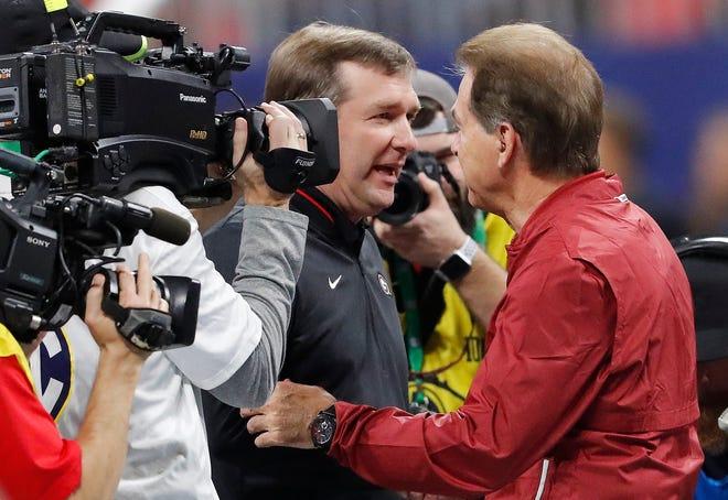 Georgia head coach Kirby Smart, left, speaks with Alabama head coach Nick Saban ahead of the Southeastern Conference championship NCAA college football game between Georgia and Alabama, Saturday, Dec. 1, 2018, in Atlanta. (AP Photo/John Bazemore)
