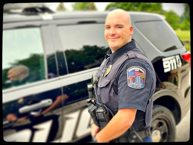 Officer Dan DeCrane is wearing the new police patch.