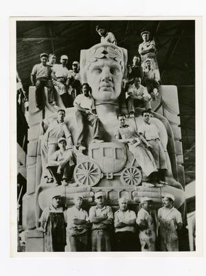 Stone carvers pose on a pylon of the Lorain-Carnegie Bridge, later renamed the Hope Memorial Bridge, circa 1931.