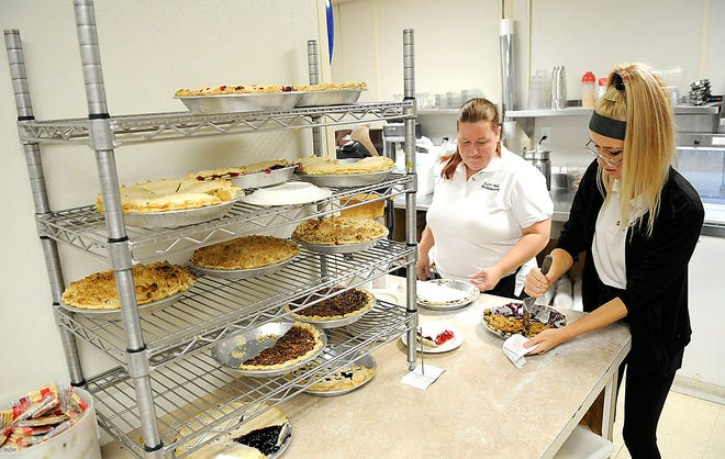 Tina Foley and Phoebe Ellis fill pie orders at Lyn-Way Restaurant in Ashland.