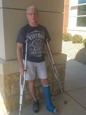 Bicycle enthusiast Larry Ritland sports a cast after breaking his ankle in June of 2020. In May of 2021, he broke a bone in his foot after a pickup truck ran into him as he was cycling. Ritland has overcome both obstacles to ride in RAGBRAI this week.