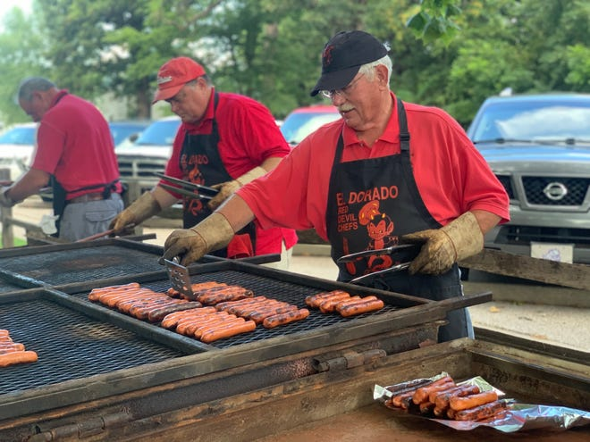 The El Dorado Red Devil Chefs prepare hot dogs for National Night Out 2019.