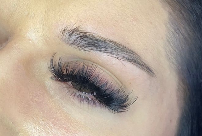 Pictured is an example of services offered by Chloë Noelle Beauty at her salon, DOLLHOUSE. The client received lash extensions in the style Volume.