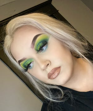 Pictured is Chloë Noelle Hill with a cut crease eye makeup look. She teaches makeup classes to instruct how one may achieve a dramatic look such as hers or even something more natural.