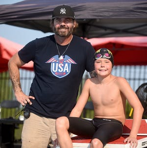 Bobby Campbell poses with his son Jack, 11, who is No. 4 in the country in his age category of the 200-meter butterfly in long-course races.