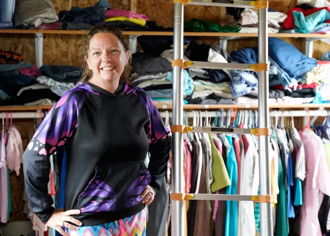 Theresa Posten, the owner of Save n Swap, 4502 Bailey Highway, stands inside of her business location earlier this week in Adrian. The Save n Swap is a place where people can go to get clothing, baby items, shoes, blankets,towelsand even seasonal items for free, no questions asked.