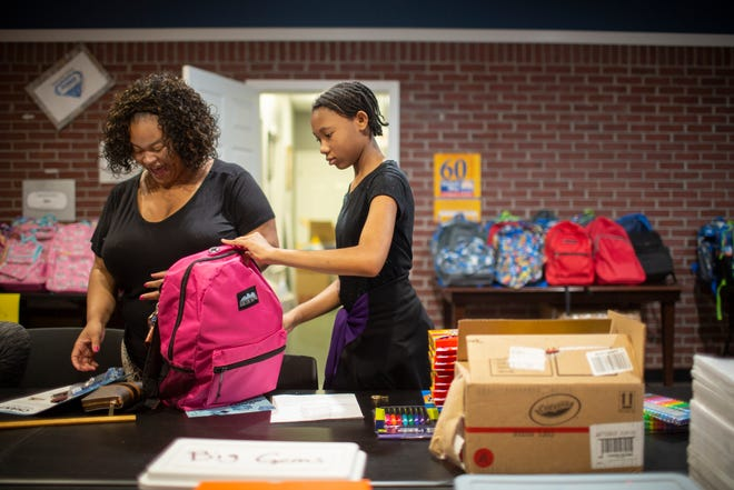 Gwendolyn Hill and Keanna Hill, 12, choose from a selection of classroom supplies at a back-to-school giveaway at The Family Center in Columbia, Tenn., on Friday, July 23, 2021. The center has surplus backpacks available. Families can also participate in the statewide tax fee weekend starting Friday at area stores in which supplies, clothing and most food will be tax free.