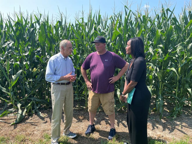 Sen. Tom Carper, left, visited the farm of Blaine Hitchens, center, along with Kasey Taylor, right, of the Natural Resources Conservation Service. Carper, Taylor and Hitchens discussed the Growing Climate Solutions Act, legislation currently in the U.S. Senate that would help farmers monetize their conservation efforts.