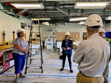 Sen. Maggie Hassan speaks with Somersworth School District officials about the construction of the middle school's HVAC system.