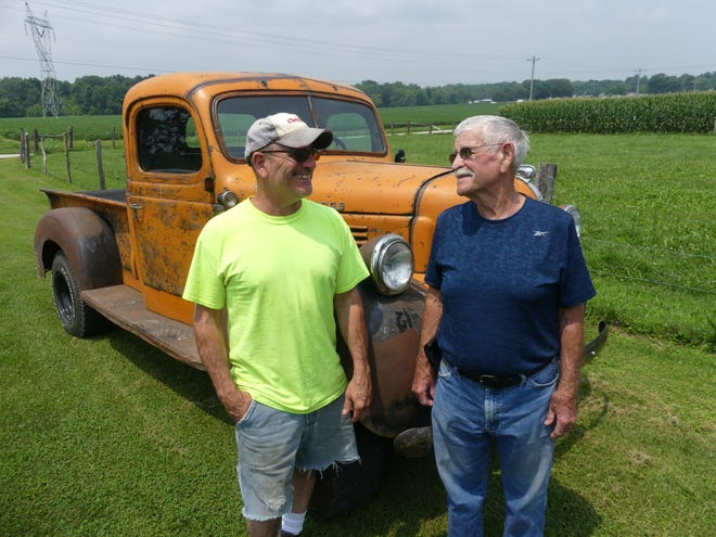 Corey York, left, and his dad Larry York spent months fixing up this 1947 Dodge pickup truck, which sits on the frame of a 1972 Jeep CJ-7.