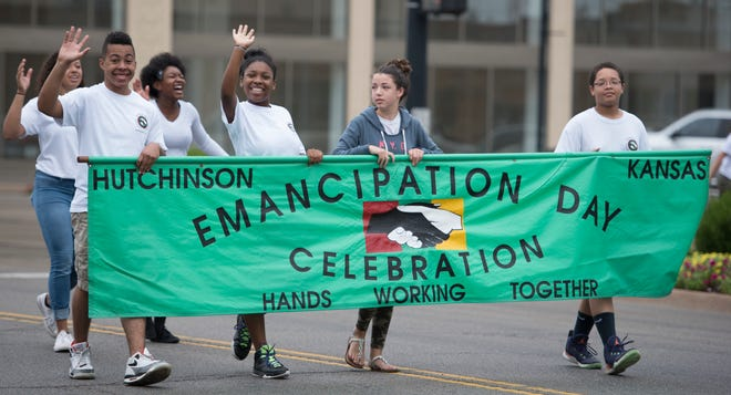 """Members of """"Hands Working Together"""" from St. John CME Church lead the Emancipation Day Parade down Main Street, in this file photo from August 06, 2016."""