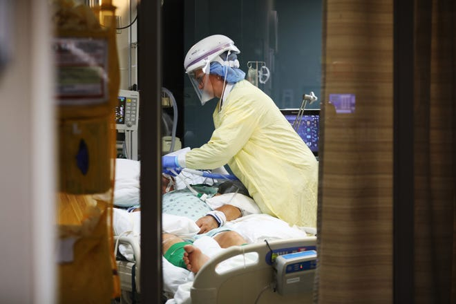Blessing Hospital nurse Lisa Surratt adjusts devices connected to a COVID-19 positive patient at the hospital's intensive care unit Thursday, July 8, 2021, in Quincy, Illinois. (John J. Kim/Chicago Tribune/TNS)