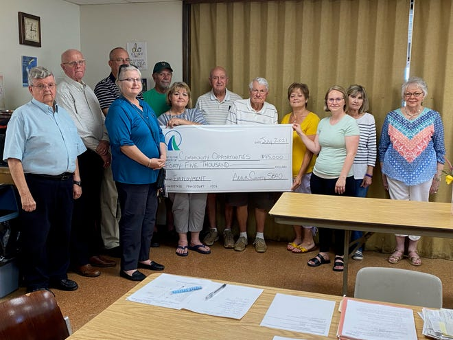 Community Opportunities' board members accept a check for $45,000 from Adair County Senate Bill 40. Crystal Aminirad, SB40's executive director, is on the left in blue. Arthythe Curtis, Community Opportunities' executive director, is to Aminirad's left.