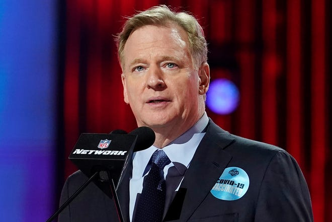 NFL commissioner Roger Goodell, wearing a COVID-19 vaccinated sticker, speaks during the first round of the NFL football draft in Cleveland.