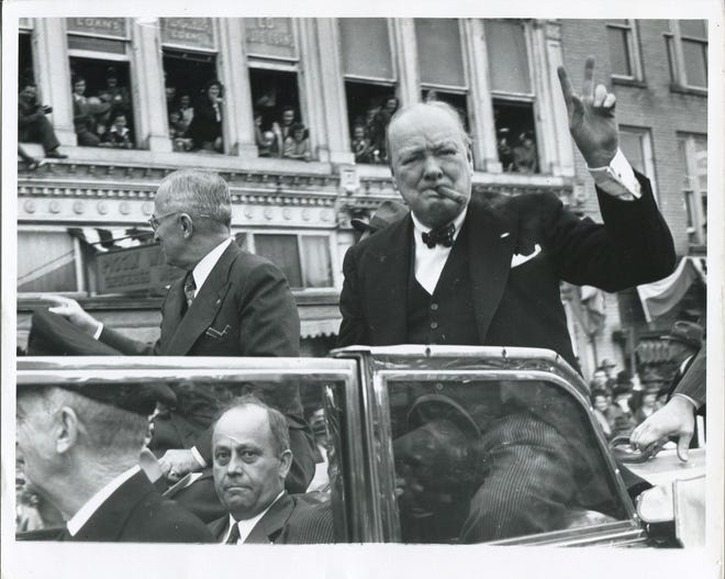 Winston Churchill greets crowds during a parade through Fulton in 1946. Photo courtesy of the National Churchill Museum