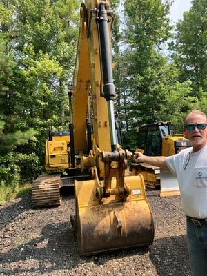 Alan Qualls shows some of the new equipment CCC has purchased to train students on in its heavy equipment operator course.