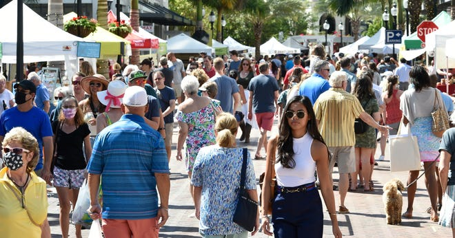 Tourism in Sarasota County was strong in June. Pictured is the Sarasota Farmers Market.