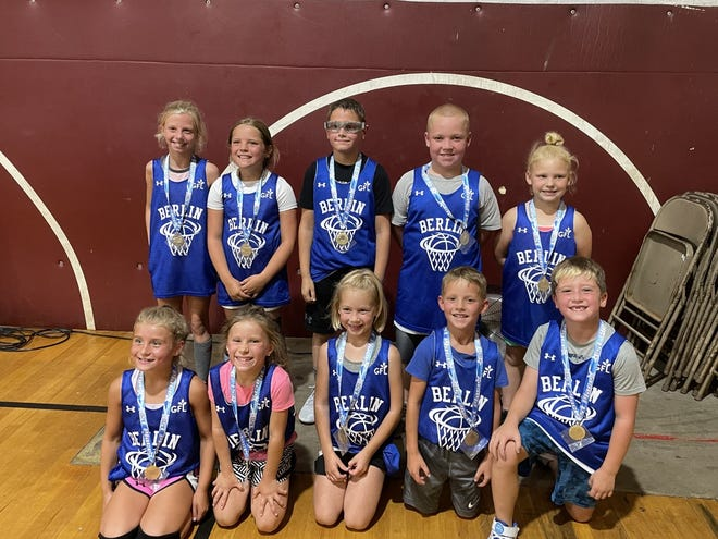 The Berlin kindergarten through third grade co-ed basketball team played in the Mountain Fellowship Center Summer League in Markleysburg. The team went 7-0 and won the championship 22-11 against Garrett on July 21. Pictured are team members, front row, from left, Madisyn Weighley, Morgan Svonavec, Rylan Kline, Bryson Yachere and Beau Courtney, back, Payton Harbaugh, Laina Milburn, Cooper Kordell, Gannon Shepley and Macie Shepley. Absent from the picture was Jace Engle. The team is coached by Tim Weighley and Mike Harbaugh. They are sponsored by GFL Environmental and the Berlin Basketball Boosters.