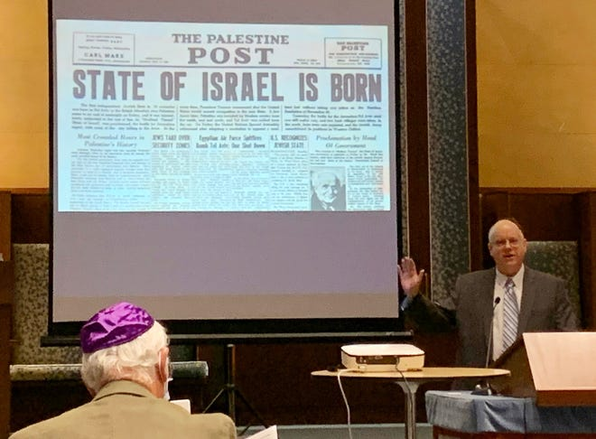 Robert W. Bleakney spoke about the Exodus 1947 and its mission, the Rev. John Stanley Grauel's role leading up to and during the operation, his friendship with Judge Joseph Goldberg, and the birth of the State of Israel.