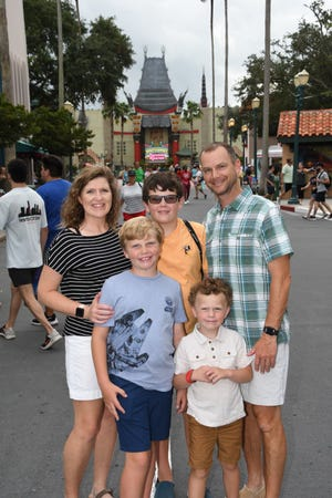 Jeff Prewitt and his wife, Megen, are seen on vacation with their three sons. It was one of his sons who inspired Prewitt to go into administration, which led to his new position as Southside High School principal.