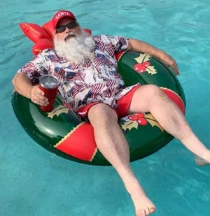 Santa Claus chills out in summer mode as he gets ready for the Waxahachie Downtown Merchants Association's Christmas in July on Saturday.