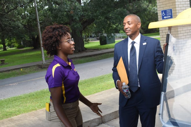 Junior chemistry major and LSUA student ambassador Destiny Harrison talks with Louisiana State University  president William Tate after the toured the LSUA of Alexandria campus Friday. Tate spoked at a campus forum and a VIP community reception was held later in the day.