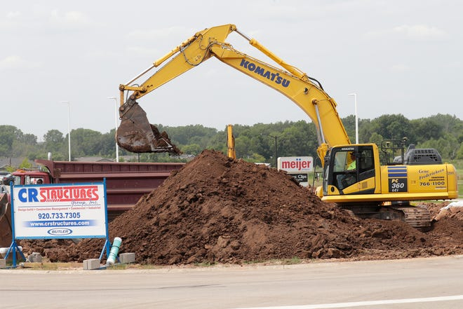 Gene Frederickson Trucking Inc. removes large amounts of dirt as work continues on the construction site of a new Arby's at 715 W. Evergreen Drive in Grand Chute.