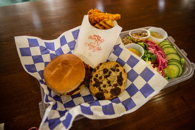 Buxton Chicken Palace's market salad, spicy chicken sandwich,  chocolate chips cookies, and seasoned waffle fries.