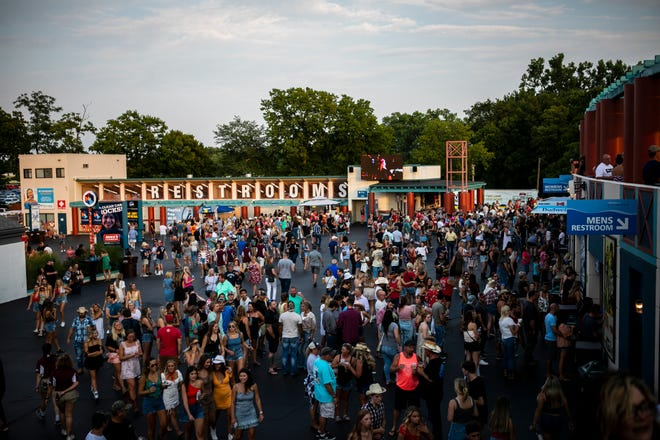 People make their way into Riverbend Music Center for the Luke Bryan Concert on Thursday, July 22, 2021.