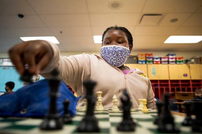 Kenya Davis sets up her chess board before playing her instructor Josiah Davis (no relation) during the Cincinnati Public School's Summer Scholars program at Mount Airy School on Monday, June 29, 2021 in Mt. Airy.