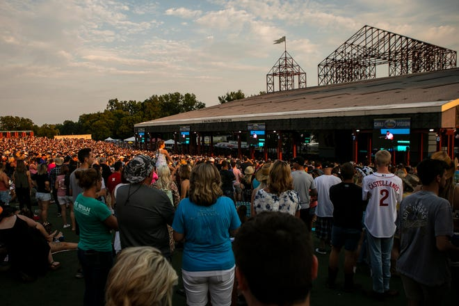 People watch Dylan Scott perform prior to Luke Bryan taking the stage for a sold-out crowd at Riverbend Music Center on Thursday, July 22, 2021.