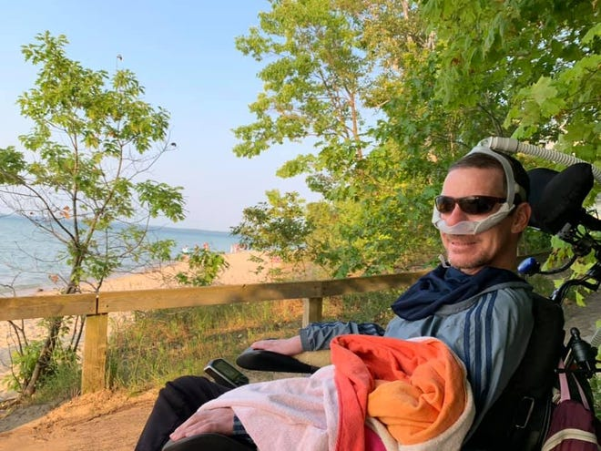 Manny Dines recently visited Mission Point Lighthouse in northern Michigan with this family. Dines, who has ALS, was able to travel after receiving a wheelchair-modified van thanks to support from Glenn Stevens and others.