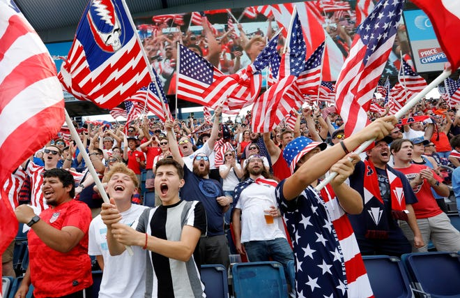 United States soccer fans react before a CONCACAF Gold Cup soccer match against Canada in Kansas City, Kan., Sunday, July 18, 2021.