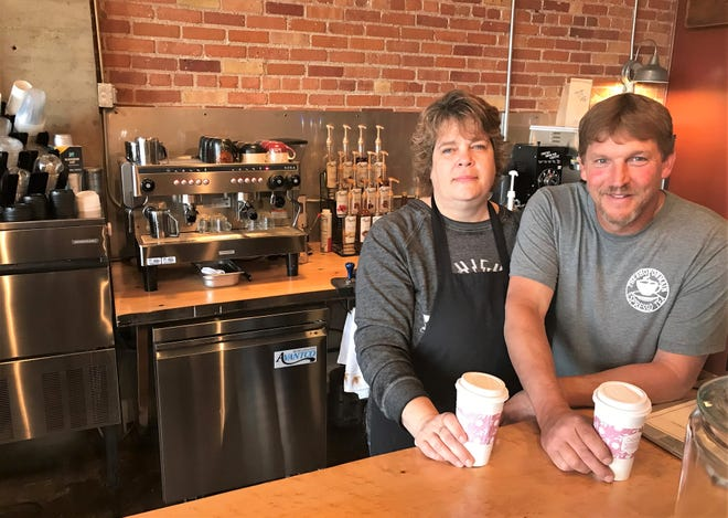 Lynne and Todd Hearley of Oconto are seen at the counter of their new coffee, tea and ice cream outlet on Main Street in Oconto.