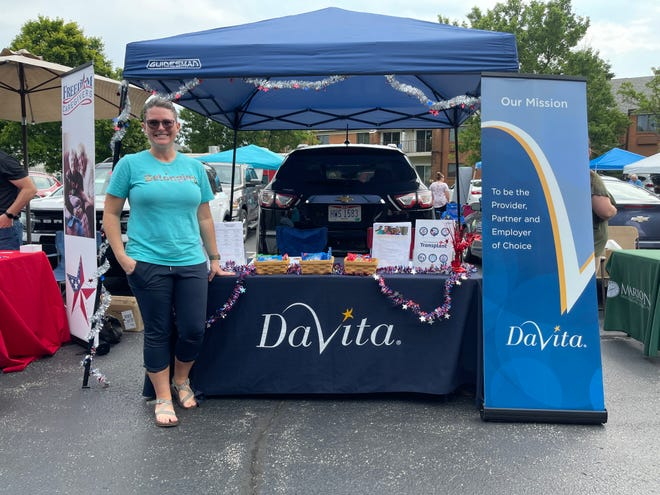 Lindsey Miller, a registered nurse and facility administrator at DaVita Heart of Marion Dialysis, stands in the Kingston Residence of Marion parking lot to talk with the community about the different offerings DaVita has for dialysis.
