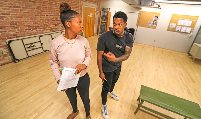 """Milwaukee director Dimonte Henning, left, works with actor Camara Stampley on the play """"Pretty Fire,"""" part of the 2021 Milwaukee Black Theater Festival."""