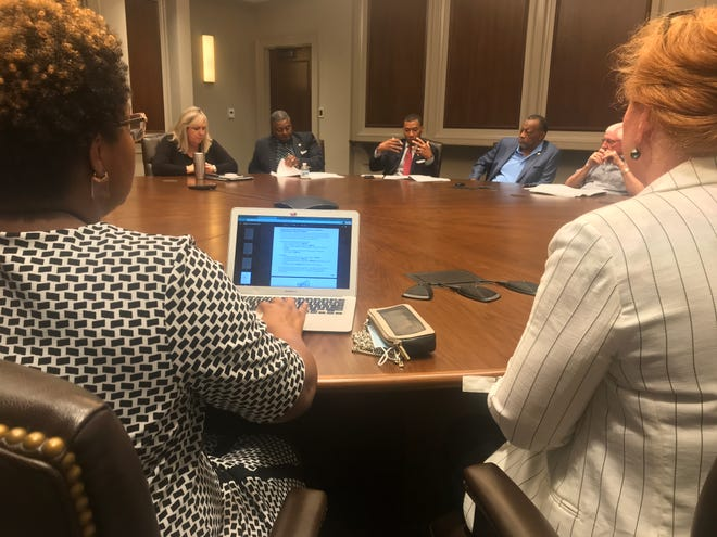 Levitate Legal & Consulting attorneys Terry Reynolds, left, and Susan Kennedy listen as Montgomery city and county leaders ask questions during a Friday meeting about federal grant funds.